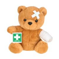 Teddy bear with bandage isolated on white